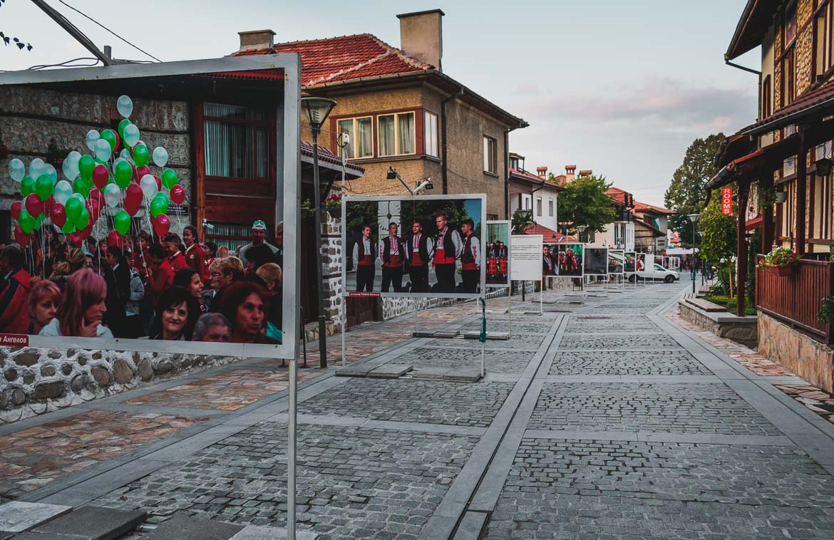 This photo shows Pirin Street which is the main street in Bansko Bulgaria. Hoppa airport transfers. How to get from Sofia to Bansko Bulgaria.