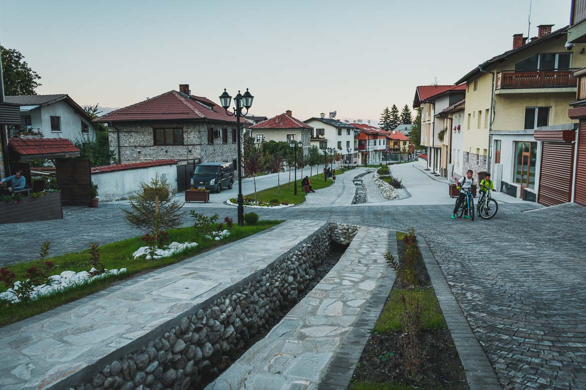 This photo shows recently pedestrianised Gotse Delchev Street in Bansko Bulgaria. Hoppa airport transfers. How to get from Sofia to Bansko Bulgaria.