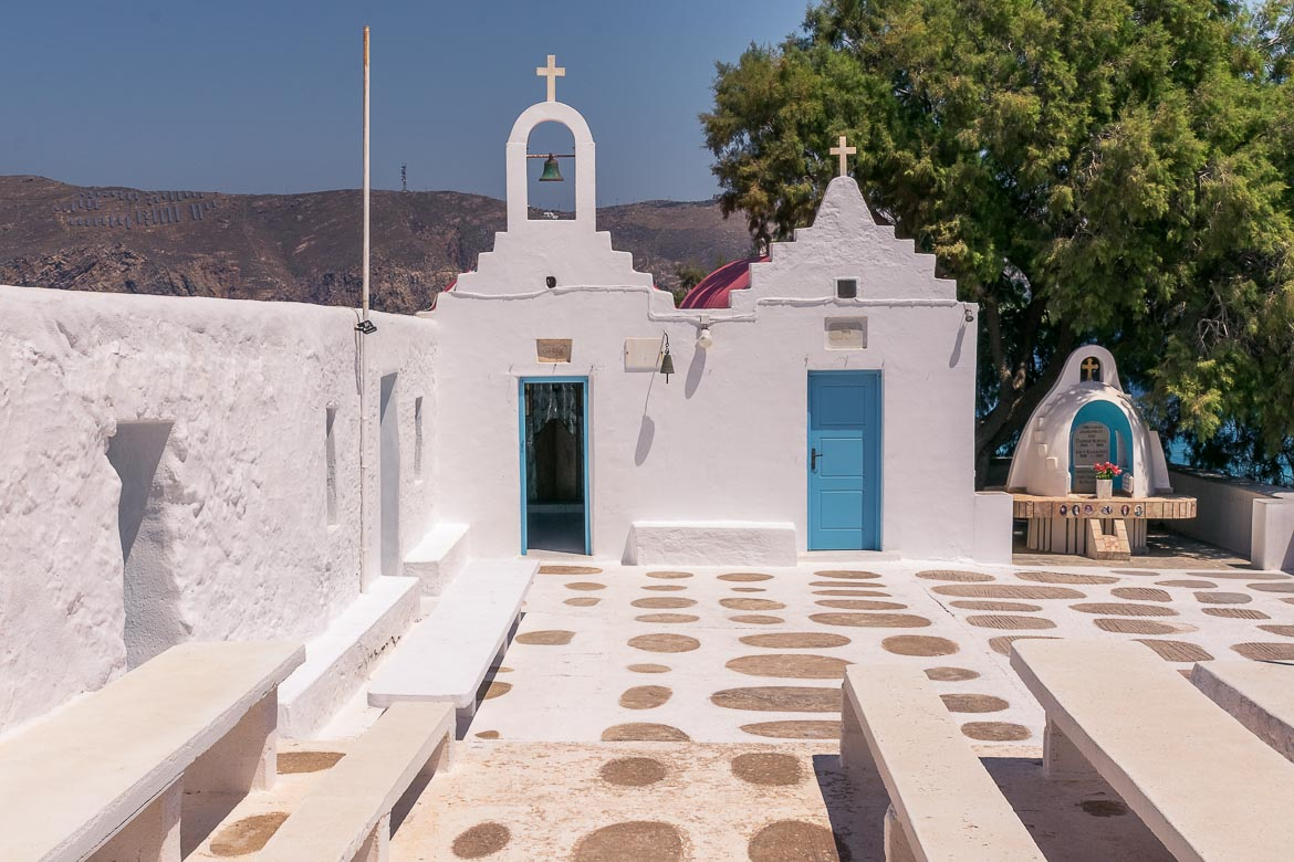 This photo shows two super tiny and dazzlingly white chapels near Agios Sostis Beach in Mykonos.