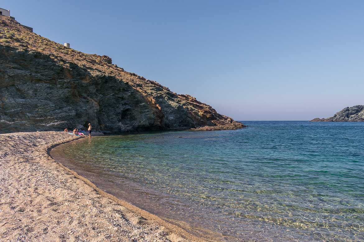 This is a photo of Fokos Beach, one of the most pristine beaches you can explore during your 3 days in Mykonos itinerary. The waters are incredibly crystal clear and there are only a couple of people on the beach.