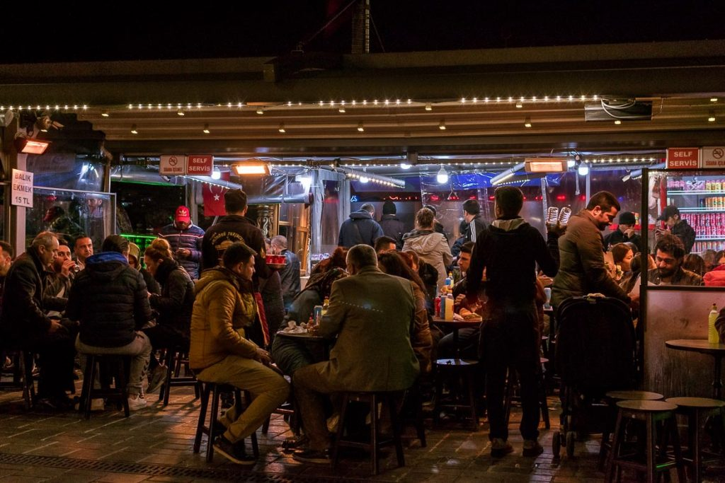 A balık ekmek restaurant packed with locals at night.