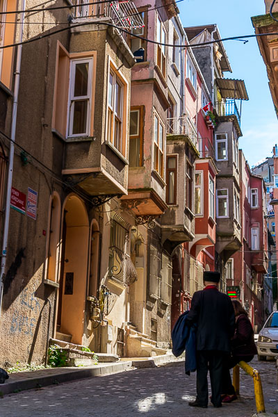 This photo shows a line of traditional wooden houses in various colours. This architecture is typical of Istanbul and it's at its best in Fener.