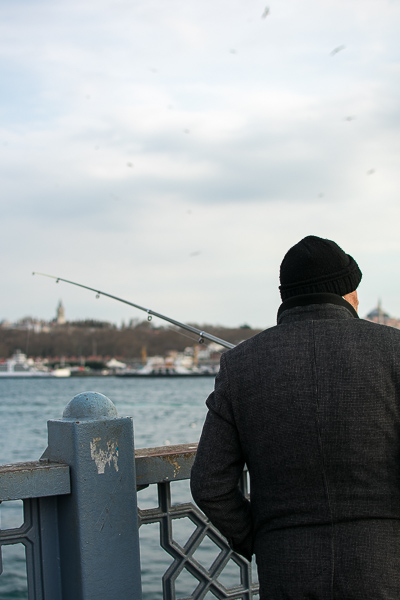 This photo shows a fisherman waiting patiently for the day's catch on Galata Bridge.