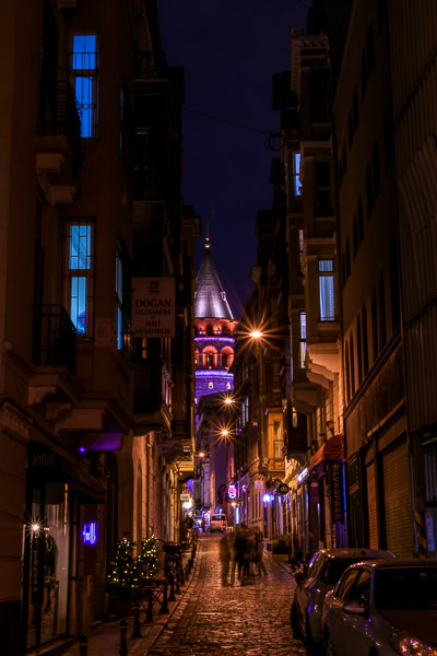 This is a night shot of Serdar-ı Ekrem Street with the Galata Tower in the backgound. Serdar-ı Ekrem Street is a cobbled street with quaint shops and cafes.