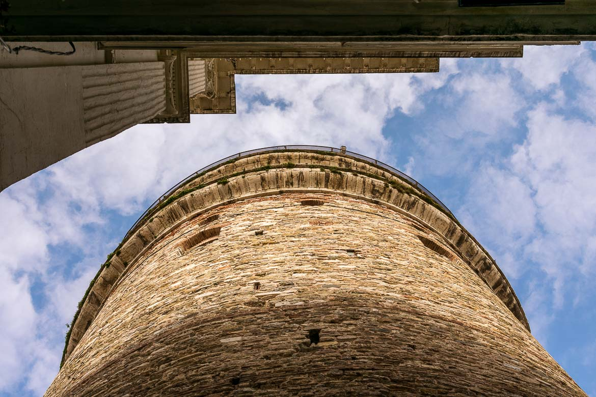 This is an up close of the Galata Tower from an unusual angle. The photo is taken from right below the tower.
