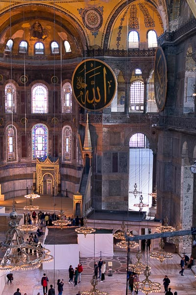 This photo shows the gorgeous interior of Hagia Sophia. The huge Quran inscriptions are placed next to Byzantine Christian saints.