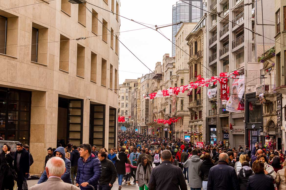 This is a photo of Istiklal Street with crowds of people.
