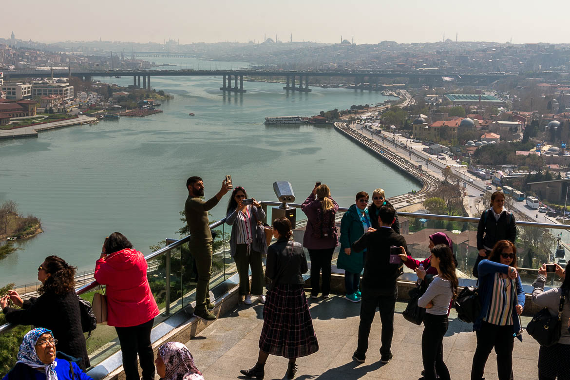 This photo shows people admiring the view to Istanbul city centre from a viewing terrace at Pierre Loti Hill.