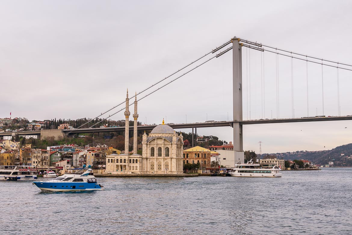 This photo shows Ortakoy Mosque with Bosphorus Bridge in the background.