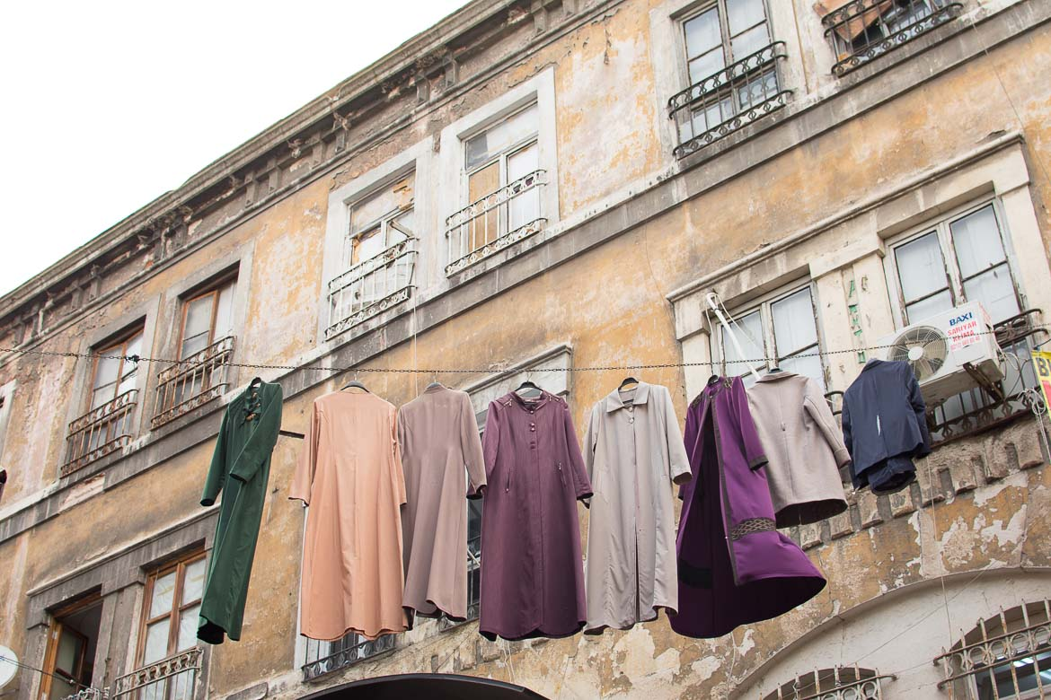 This photo shows clothes hanging high above street level at an outdoor market in Istanbul.