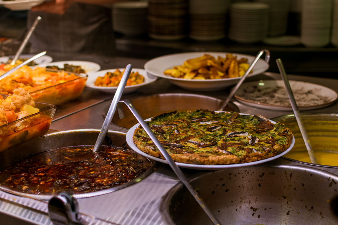 This photo shows a series of Turkish dishes on display at a traditional restaurant.
