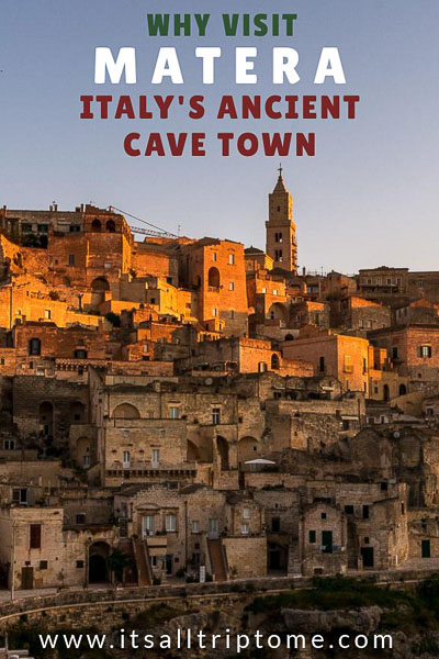 This image is optimised so as to be used for Pinterest. The image shows Matera at dawn. The text on the image reads: Why visit Matera, Italy's ancient cave town. If you like our article, please pin this image on Pinterest!