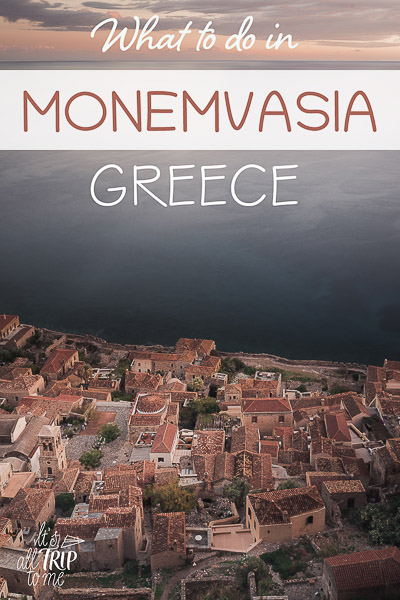 This is a panoramic shot of the red rooftops of the Lower Town as seen from the upper town. This is an optimised image for Pinterest. There is overlay text that reads: What to do in Monemvasia Greece. If you like our article, please pin this image.