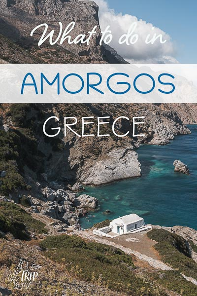This is a panoramic shot of Agia Anna Bay with the dramatic cliffs looming above the tiny bay and the quaint whitewashed church of Agia Anna. This is an optimised image for Pinterest. There is overlay text that reads: What to do in Amorgos Greece. If you like our article, please pin this image.