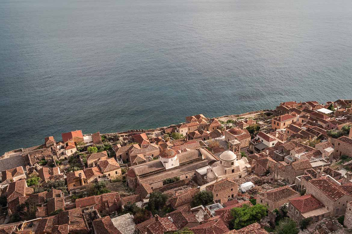 This is a panoramic view of the medieval castle town of Monemvasia from above.