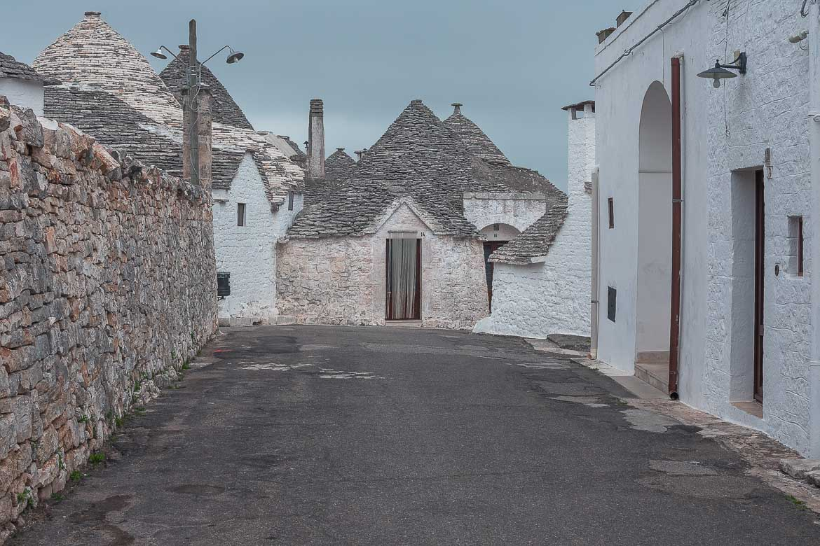 This image shows a peaceful neighbourhood in Rione Aia Piccola. The trulli look stunning and there isn't a soul around.