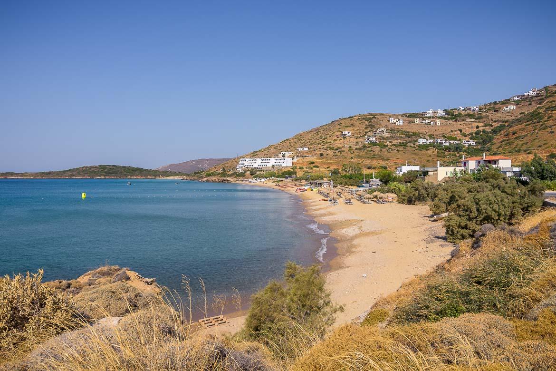 This photo shows Kypri Beach, a long sandy beach with beach bars and water sports.