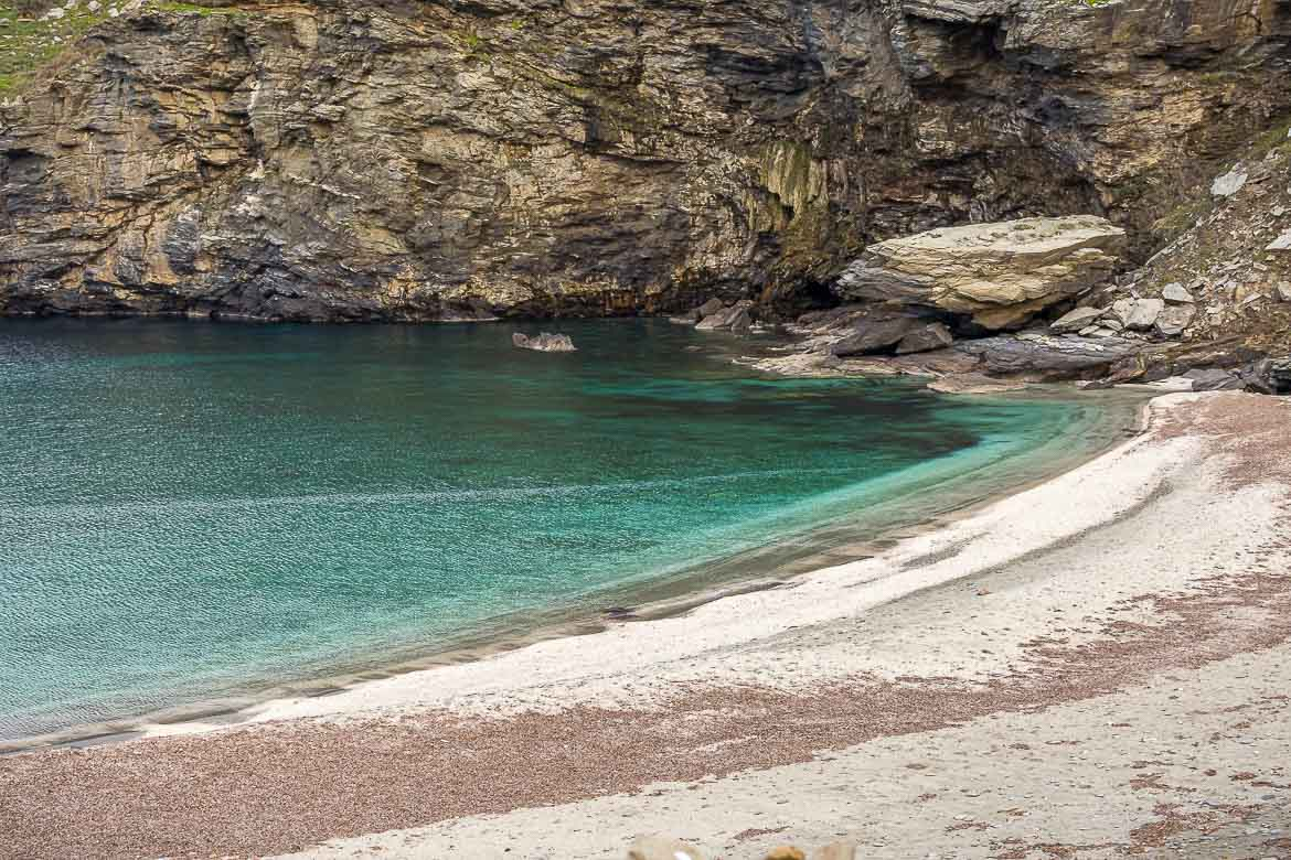 This is a shot of Syneti beach, one of the most breathtakingly beautiful of all Andros beaches. The calm sea is an incredible green colour and the sand is white.