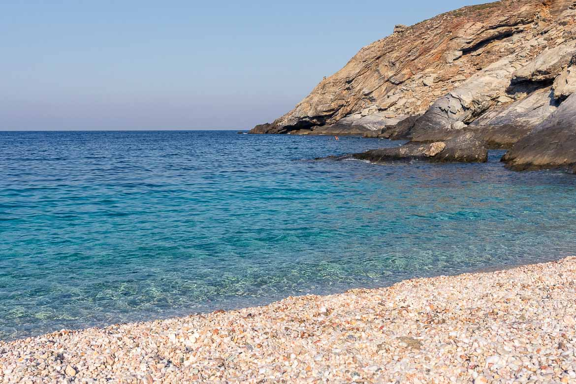This image shows the turquoise waters of Zorkos Beach on a sunny day.