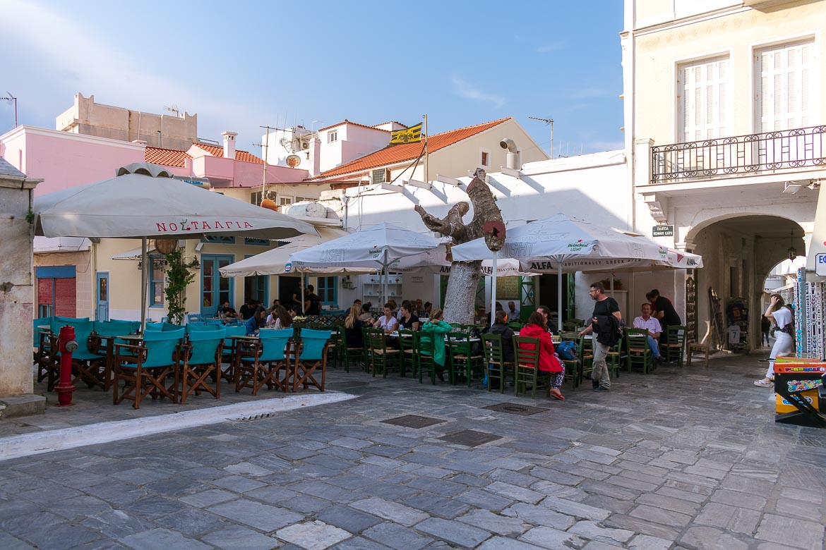 This image shows Kairis Square in Chora Andros, a picturesque square where people hang out at the traditional cafes.