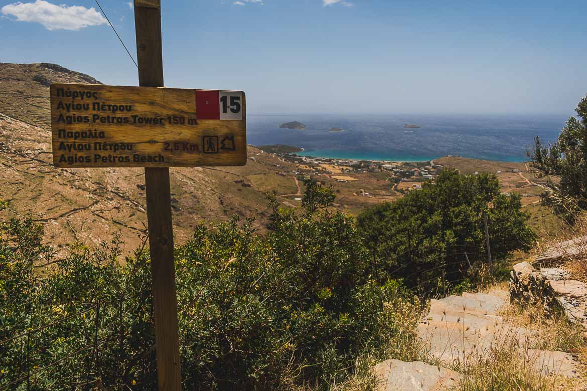 This photo shows the sign post of route 15 you can see while hiking Andros Greece.