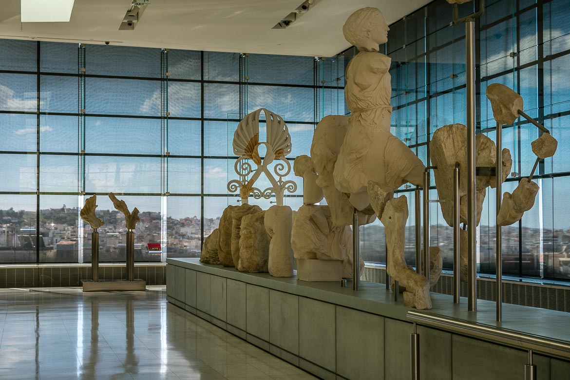 This image shows a few statues in the interior of the Acropolis Museum.