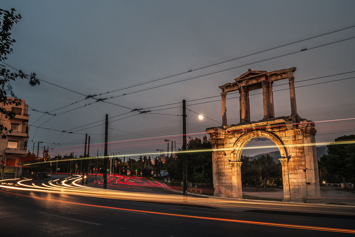 This image shows Hadrian's Gate and the light trails of traffic at night.