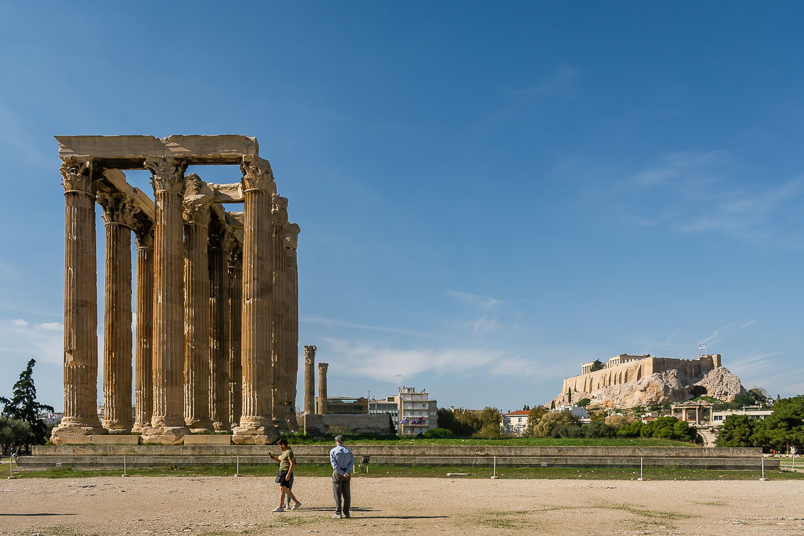 This image shows the Temple of Olympian Zeus. In the background there is the Acropolis.