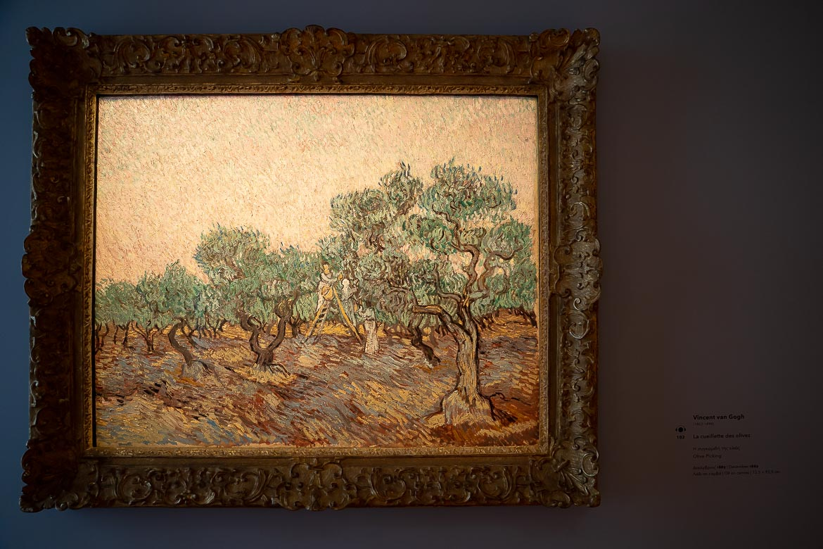 This image shows Olive Picking, a painting by Vincent Van Gogh that's on display in the Basil and Elise Goulandris Foundation in Athens.
