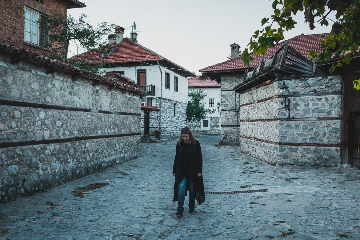 This is a photo of Maria walking around Bansko Old Town Bulgaria. One of the top 5 things to do in Bansko apart from skiing.