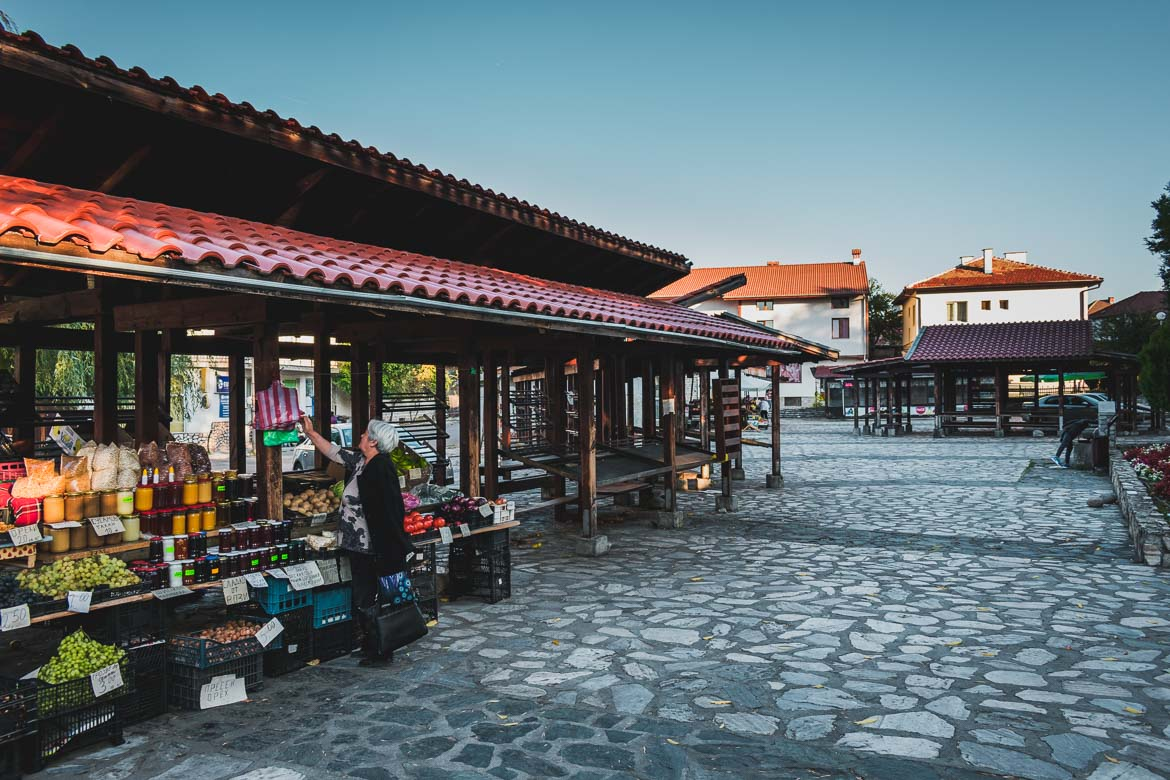 This photo shows an open air market in Bansko Old Town Bulgaria. Top five things to do in Bansko apart from skiing.