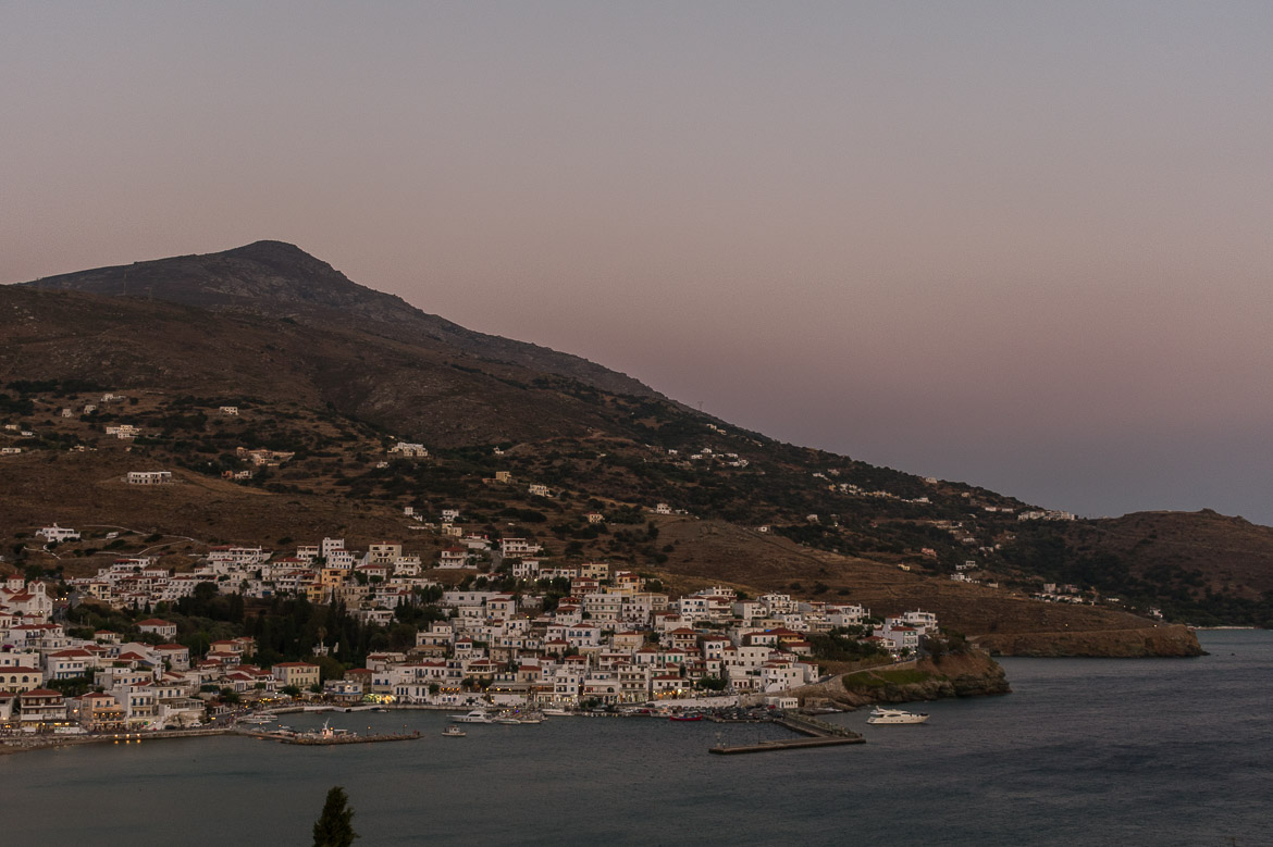 Panoramic view to Batsi at dusk. 13 unique things to do in Andros Greece and full Andros Guide.