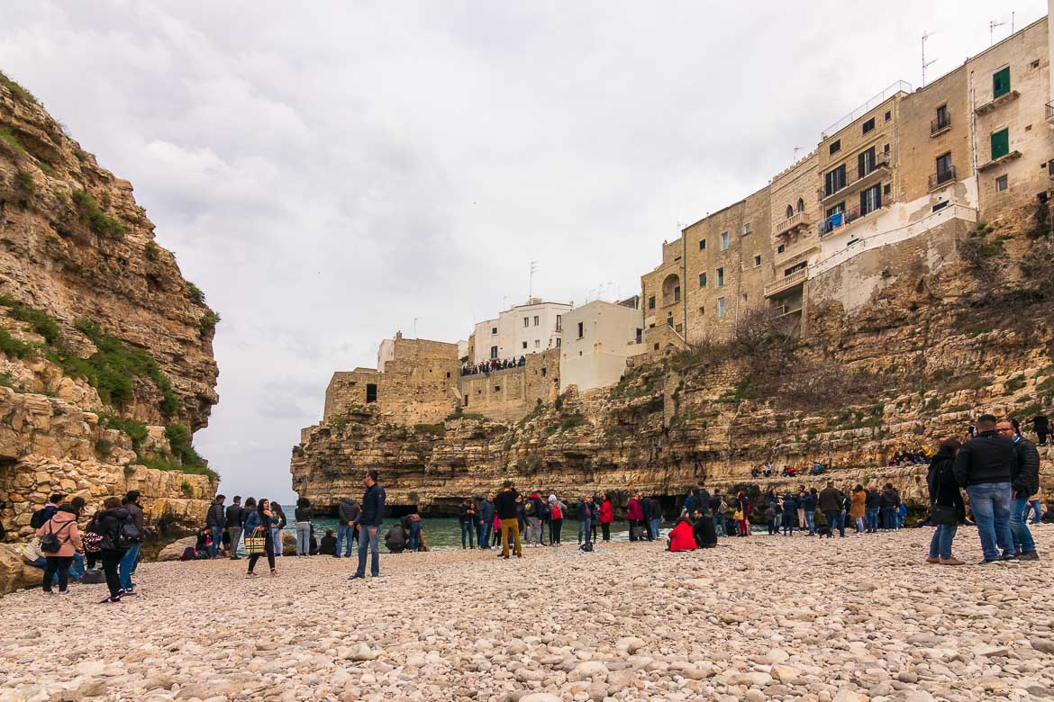 This photo was taken from the beach at Polignano a Mare. The view to the Old Town is amazing. The beautiful old buildings seem as though they are hanging from the cliff above the beach.