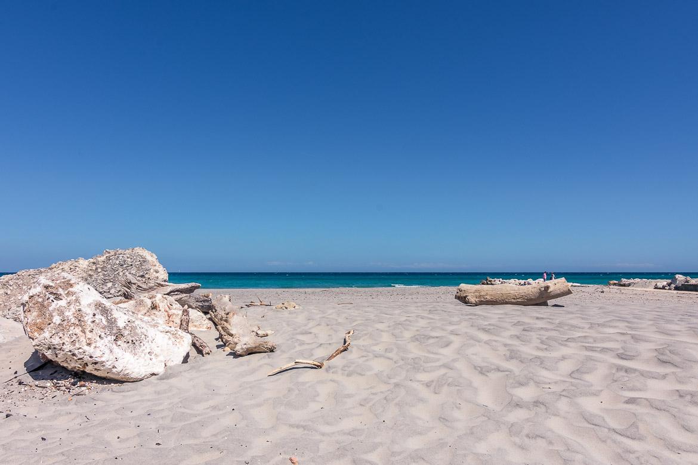 This image shows Spiaggia degli Alimini, a beach of fine white sand.
