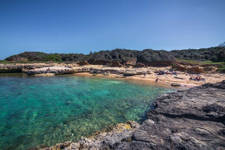 This image shows Caletta Toraiello, a pristine beach close to Baia dei Turchi beach. Although still a well kept secret, Caletta Toraiello is one of the best beaches in Puglia Italy.