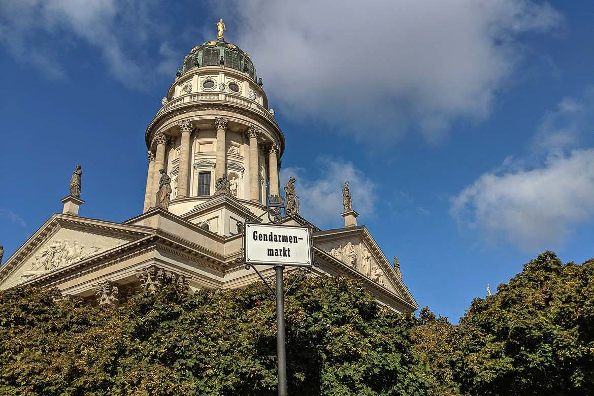 This is a close up of the German Church, an ornate building with green dome, in Gendarmenmarkt Berlin.
