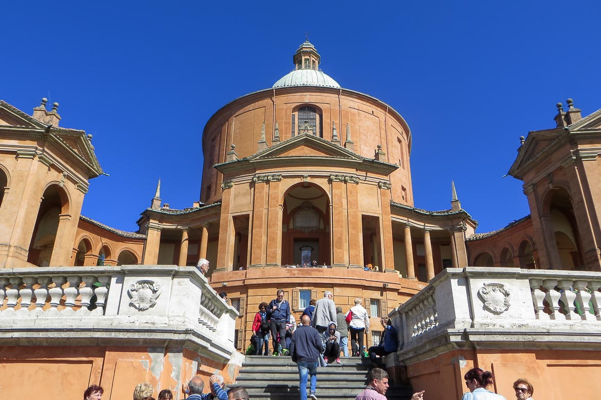 This is a close up of the church of St Luke's Sanctuary in Bologna Italy. There are many people going up and down the stairs. We think that Bologna is indeed one of the best Easter holiday destinations.