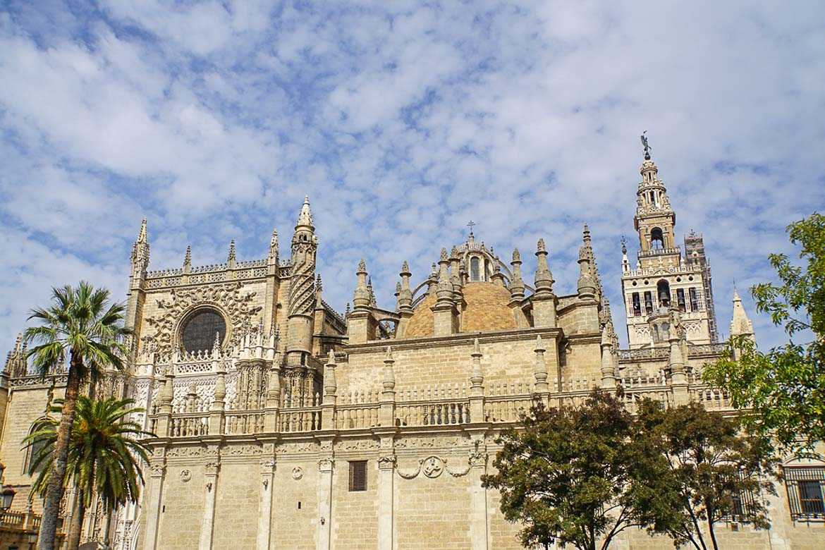 This is a close up of the facade of Seville Cathedral with its ornate decoration.