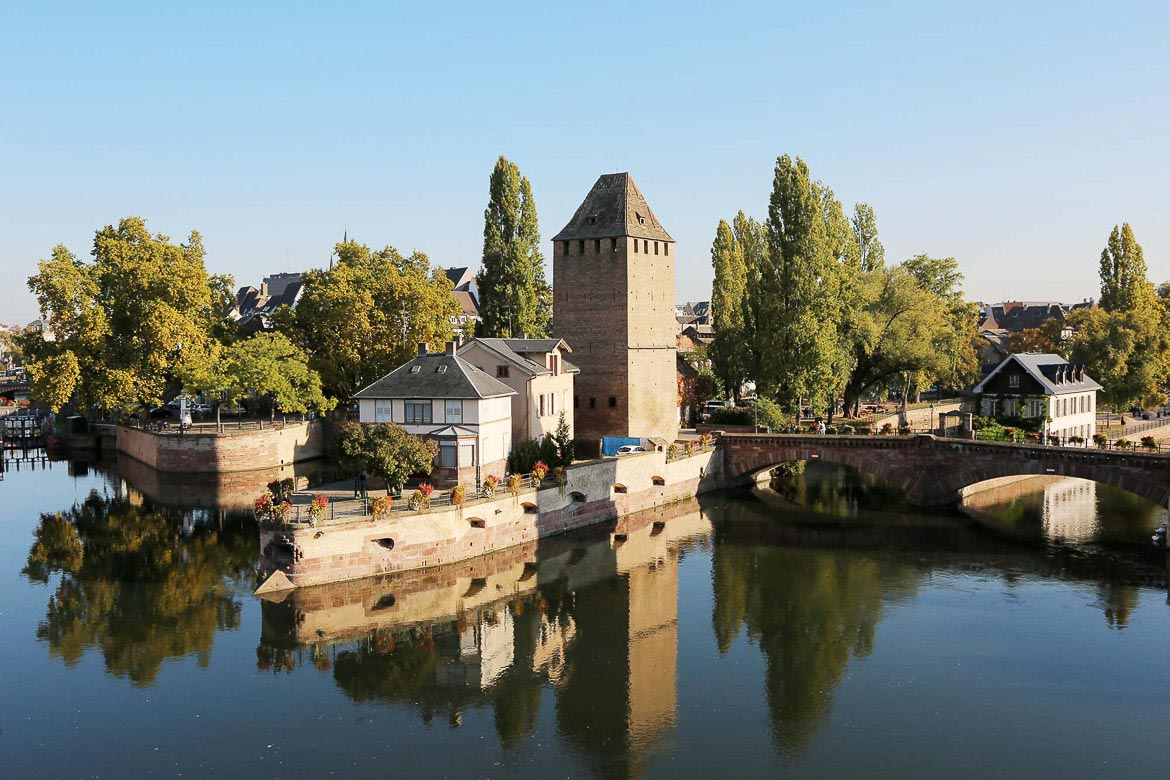 This image shows the Ponts Couverts, a defensive complex of three bridges and four towers built on the river in the city of Strasbourg.
