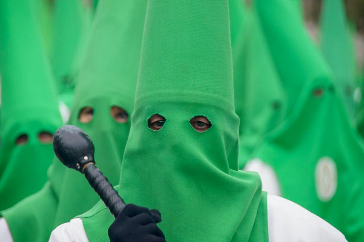 This is a close up of a couple of men in green hoods, which leave only the eyes uncovered. They are members of one of the brotherhoods that participate in the Easter Processions in Zaragoza.