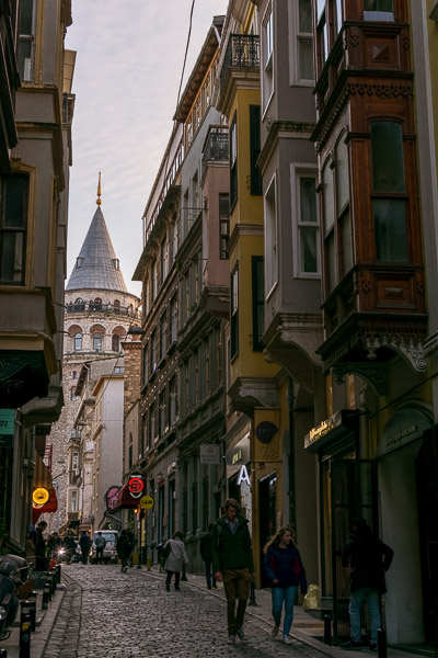 This is an image of Serdar-i Ekrem Street in Istanbul. It is a cobbled street lined with beautiful 19th century buildings. The street has a marvellous view of the Galata Tower.