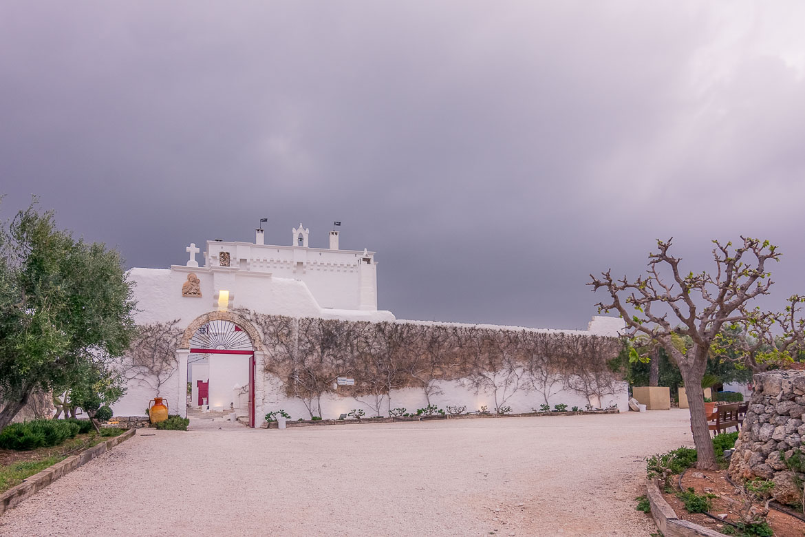 This is a shot of the entrance to the central courtyard at Masseria Torre Coccaro, one of the best places to stay in Puglia.