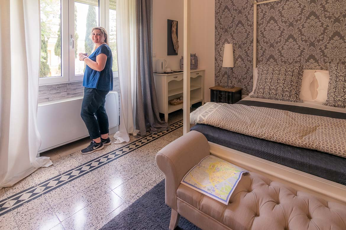 This photo shows Maria smiling at the camera. She is standing by the window in a suite at Palazzo Bignami hotel in Lecce.