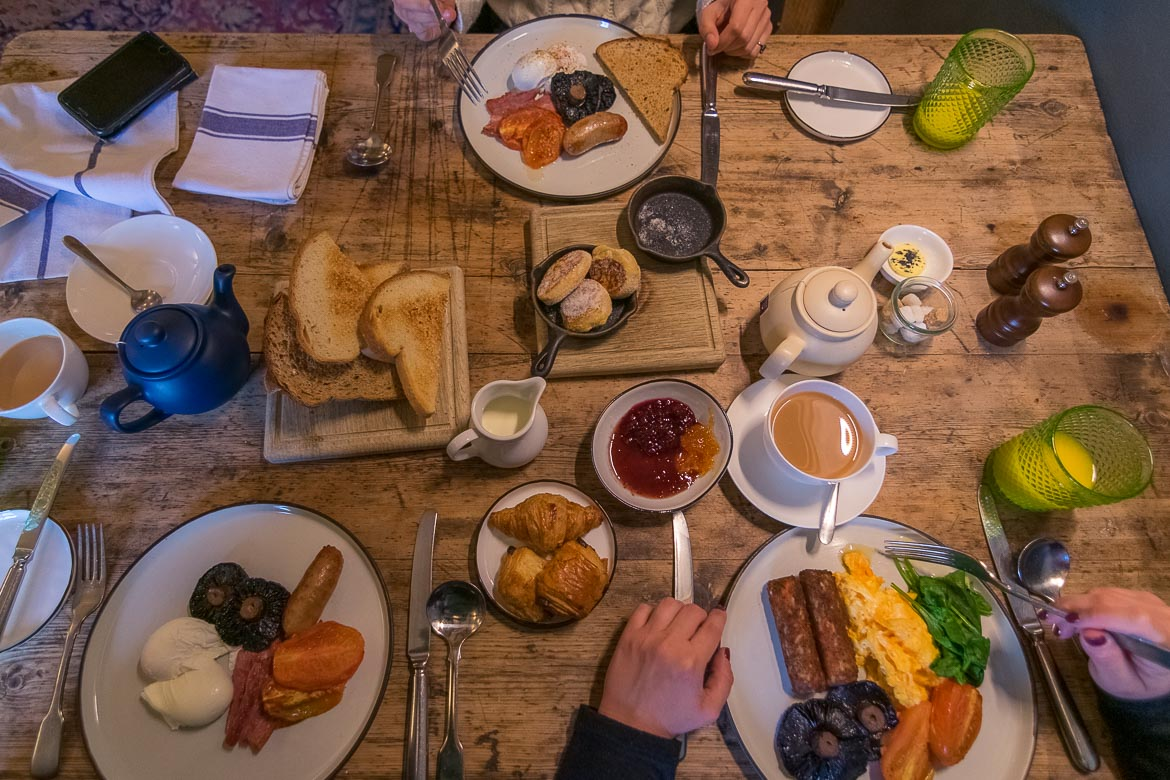 This is a shot of our breakfast table at the Kingham Plough. There is full english breakfast both standard and vegetarian version, tea, orange juice, croissants and homemade pancake-like treats that tasted divine.