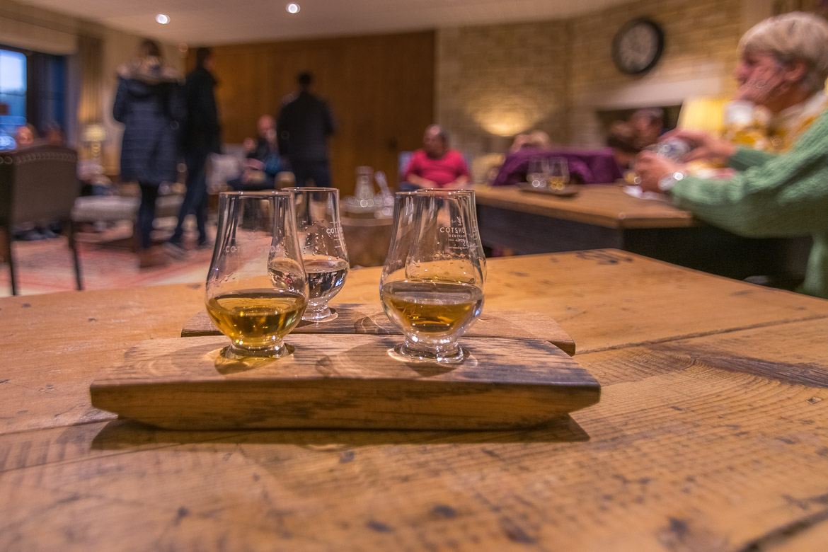 This is a close up of the spirits we tasted at the Cotswolds Distillery: gin and whisky. The tasting took place at a fabulous rustic room.