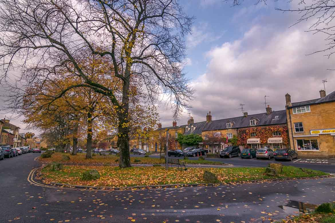 This is a panoramic shot of Moreton-in-Marsh. Autumn leaves are everywhere.
