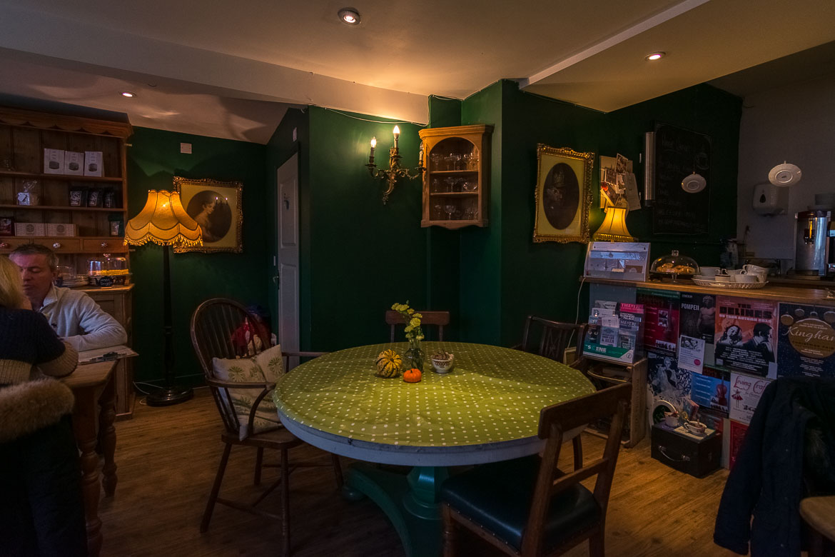 This image shows the interior of the Tea Set in Chipping Norton. It is very cosy with vintage furniture and details.