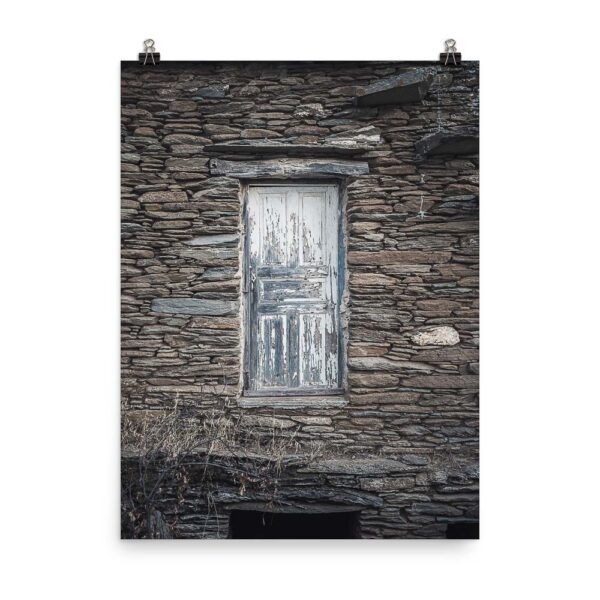 This image shows an old blue door on a stone wall in Episkopeio village in Andros Greece. This is our Blue Door Print, part of our Greece Prints collection, available for sale on our Print Shop!
