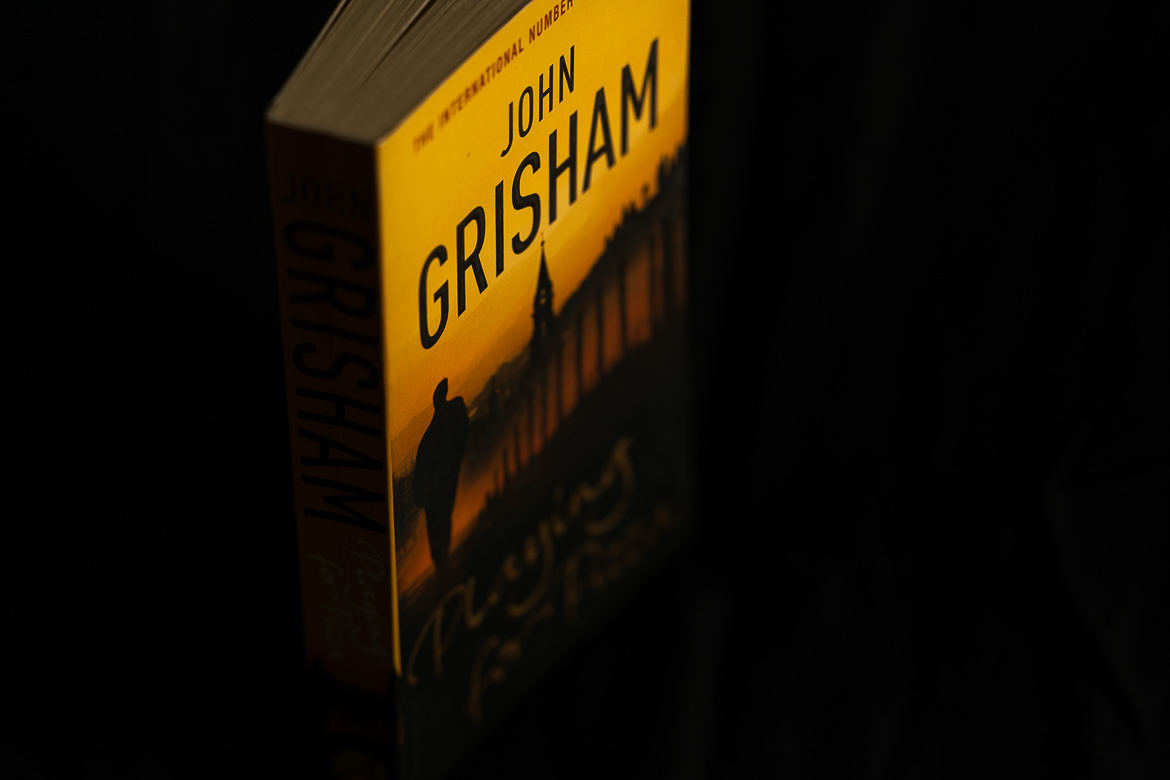 This image shows a paperback edition of Playing for pizza by John Grisham.