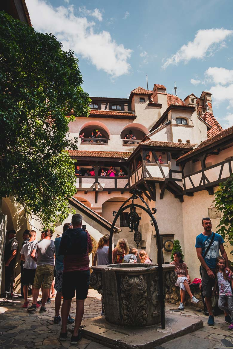 This photo shows the well at the centre of the interior courtyard in Castelul Bran. Plan a day trip from Brasov to Bran Castle.